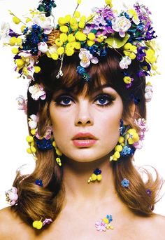 A 60's looking woman with a flower crown